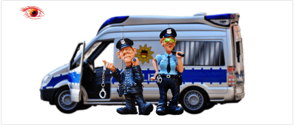 Symbolbild Polizei Polizeiauto Handschellen